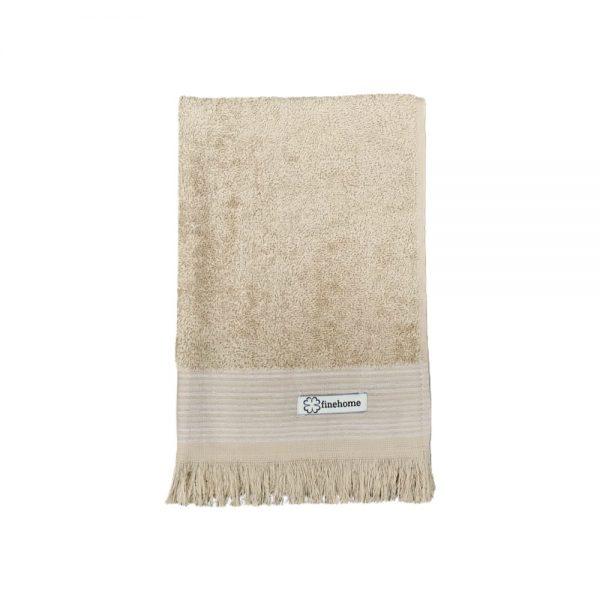 Beige gæstehåndklæde med frynser fra finehome